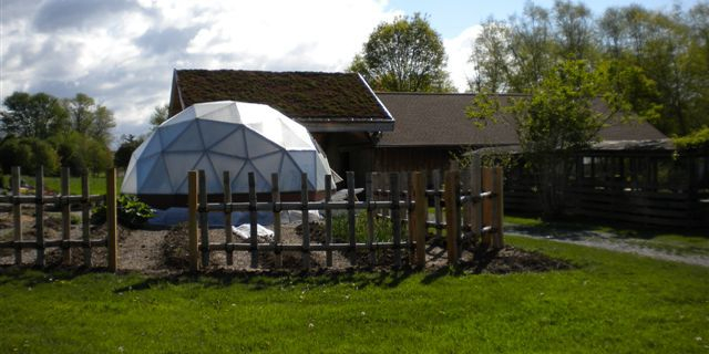 geodesic dome greenhouse on farm