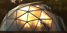 geodesic dome greenhouse at sunset