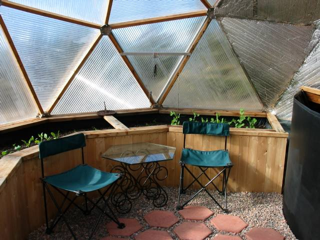 vertical slat raised beds in geodesic dome greenhouse