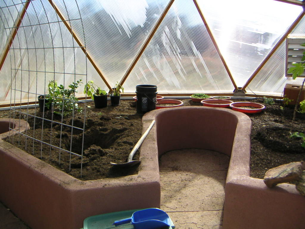 raised beds with keyholes in Growing Dome greenhouse
