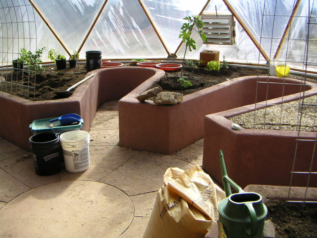 raised beds with keyholes in geodesic dome greenhouse