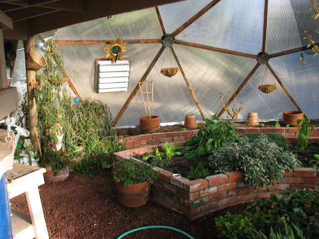 Brick raised beds in geodesic greenhouse