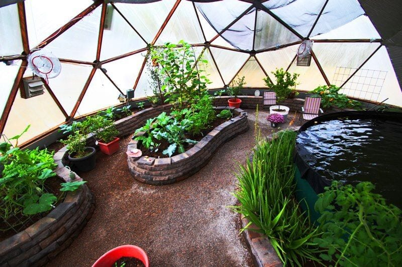 pavestone raised beds in geodesic dome greenhouse