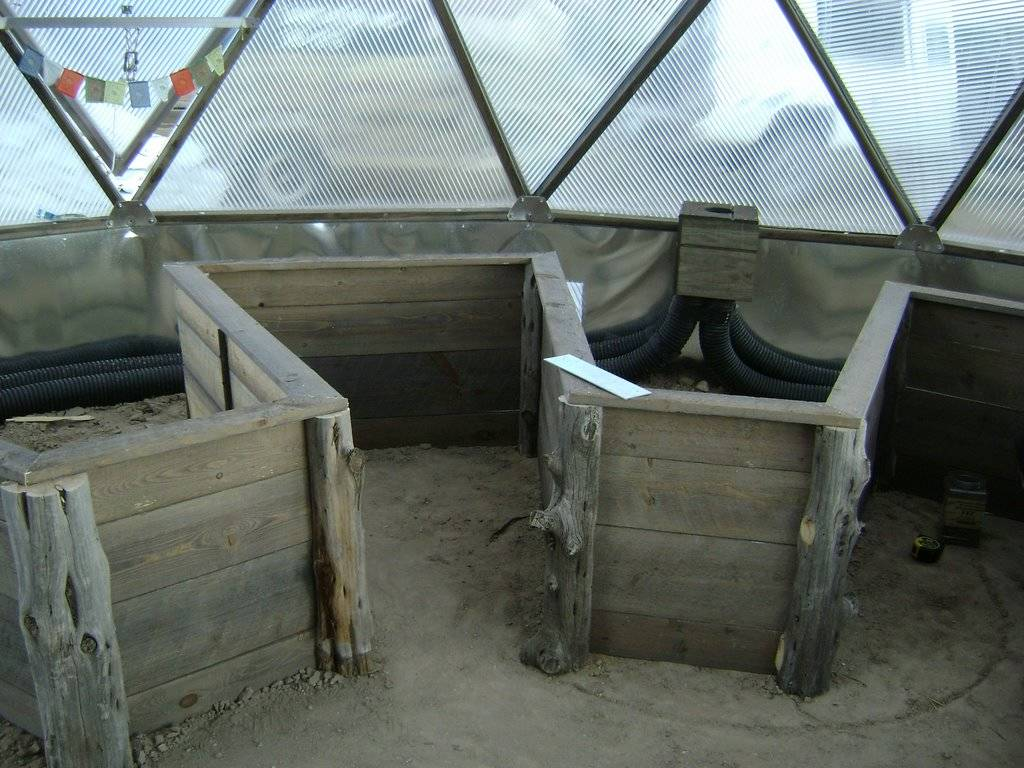 decorative corners on planting beds in Growing Dome Greenhouse