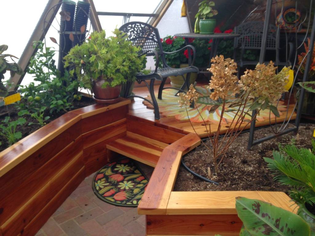 raised platform and planting beds in Growing Dome Greenhouse