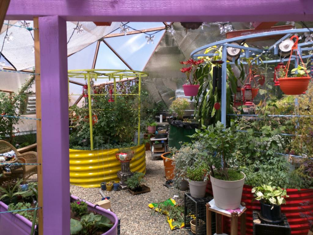 colorful planting beds in geodesic dome greenhouse