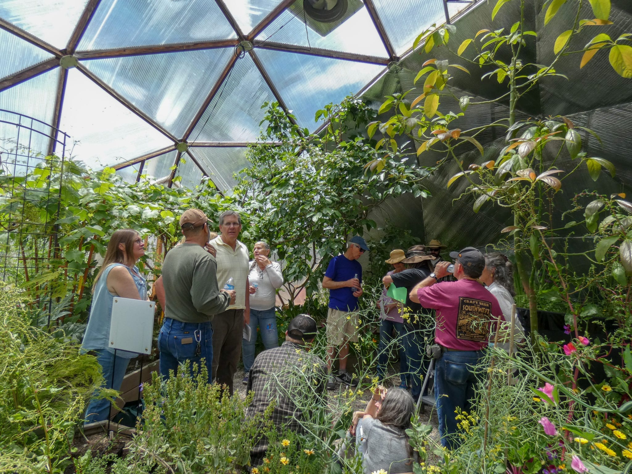 people taking a class in a growing dome greenhouse