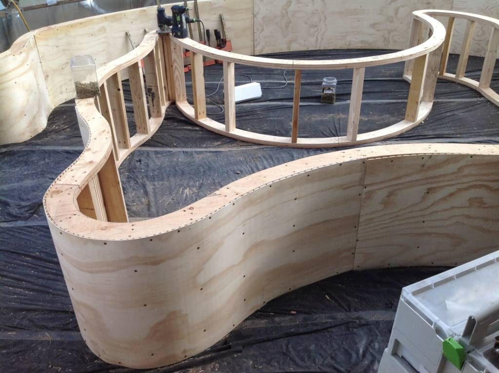 curved wooden planting beds in Growing Dome Greenhouse