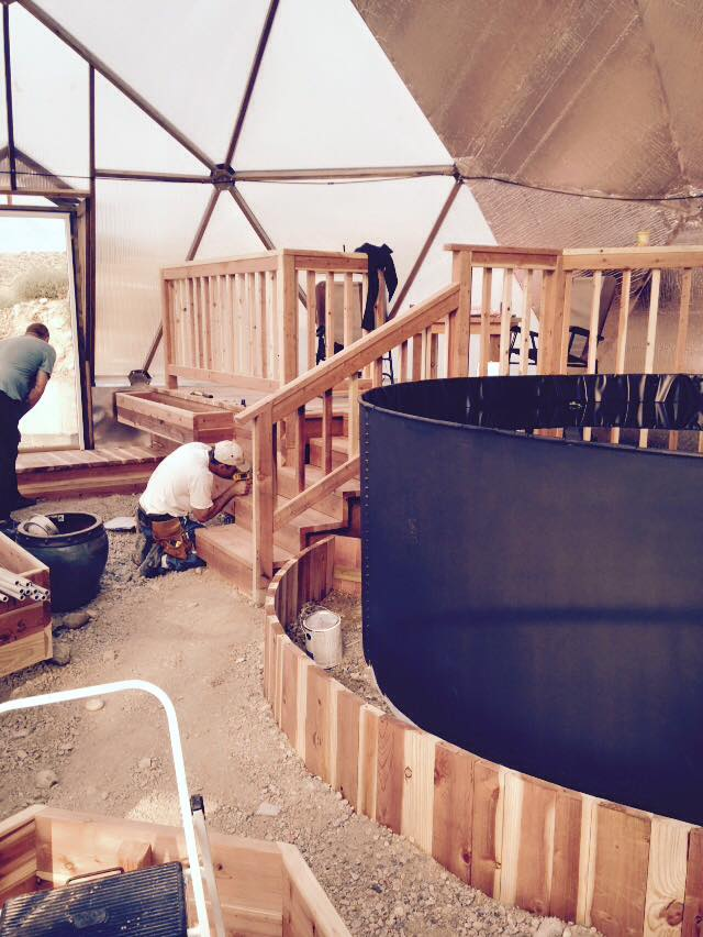 raised platform and planting beds in geodesic dome greenhouse