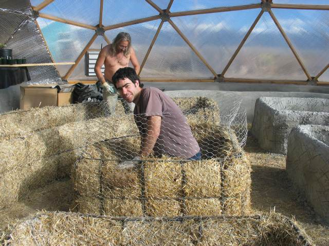 stucco planting bed construction in geodesic dome greenhouse