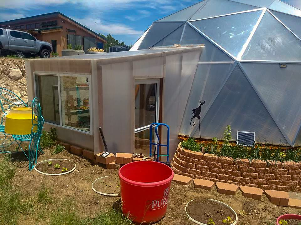 Custom air-lock and storage for geodesic greenhouse