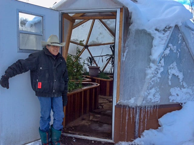 Josie showing our 18 foot Growing Dome Greenhouse
