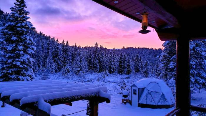 Jerry's Snow Covered Geodesic Dome Montana Greenhouse at sunset
