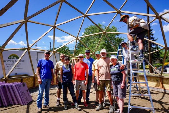 Volunteers building a 26 foot Growing Dome Geodesic Greenhouse