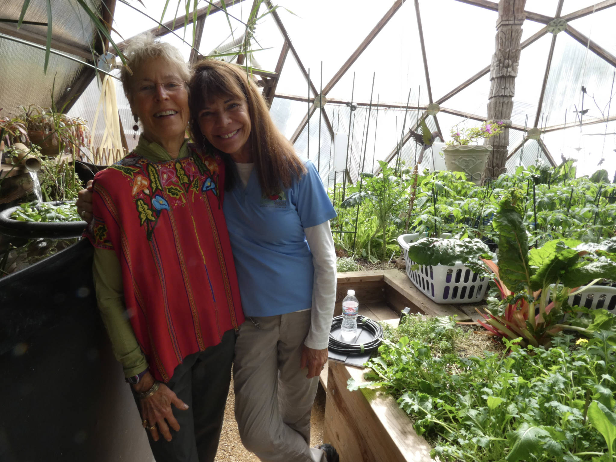Claudia and Val inside Growing Dome Greenhouse