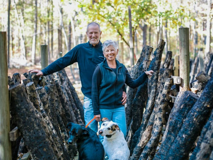 Fogwood Farms Owners sourronded by shiitake mushroom logs