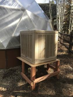 evaporative cooler mounted outside Growing Dome Greenhouse