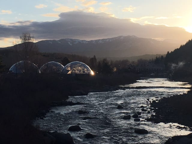 Sunset over Growing Dome Solar Greenhouses in Pagosa Springs