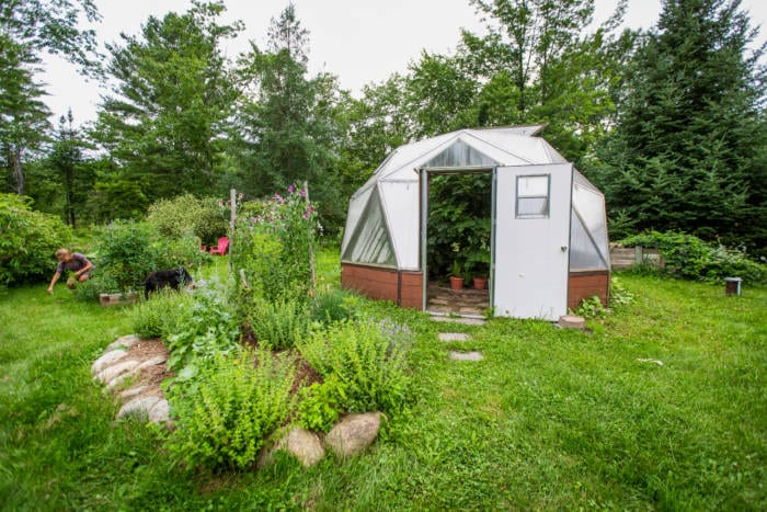 Landscaping outside sustainable greenhouse in Maine