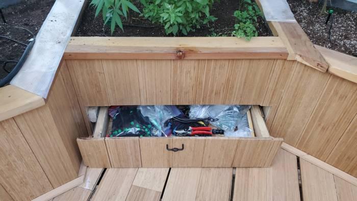 storage drawer under raised garden bed